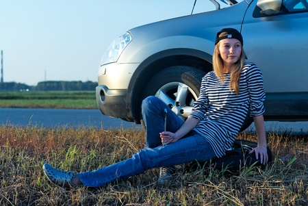 motorcar: Young Blond Woman With Her Broken Car Stock Photo
