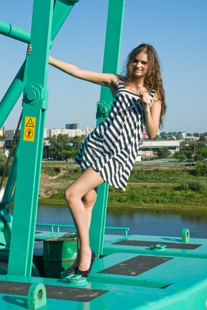 Girl on crane photo