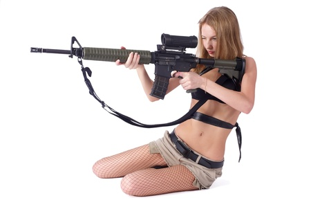 Pretty woman with rifle photo