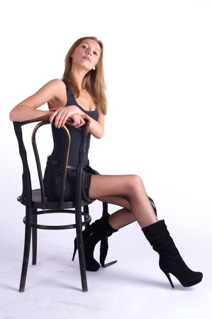 Pretty woman on old chair Stock Photo - 9606559