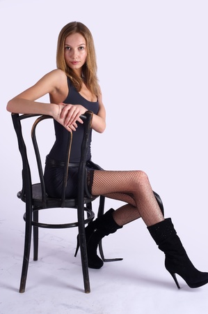 Pretty woman on old chair photo