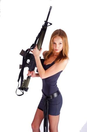 Woman with gun on white Stock Photo - 9620459