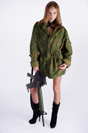 Woman with gun on white photo