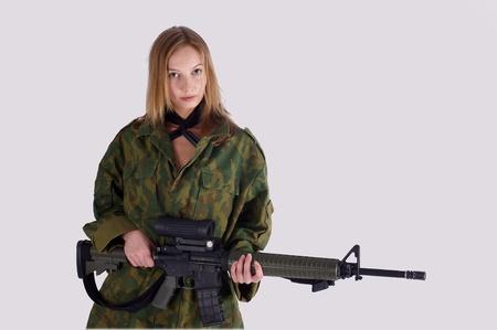 Woman with gun on white Stock Photo - 9733792