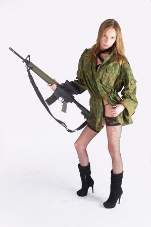 Woman with gun on white Stock Photo - 9733912