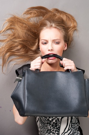 Sexy fashionable woman with bag Stock Photo - 10019759