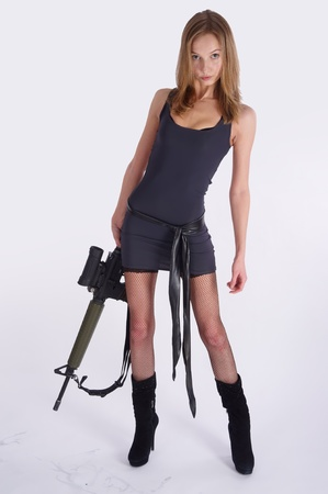 Pretty woman with rifle Stock Photo - 10459824