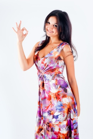 Portrait of young beautiful woman with ok gesture photo