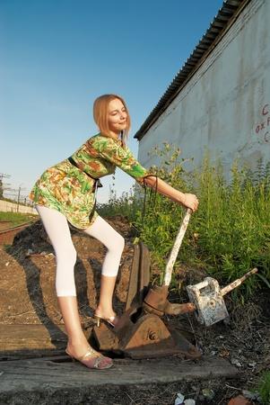 switcher: Young woman on railway Stock Photo