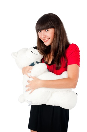 Beautiful girl playing with bear toy  Isolated on white photo