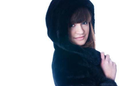 Girl in black fur coat at isolated background photo