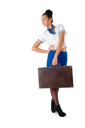 Attractive young stewardess with old suitcase, isolated over white background Stock Photo - 13094045