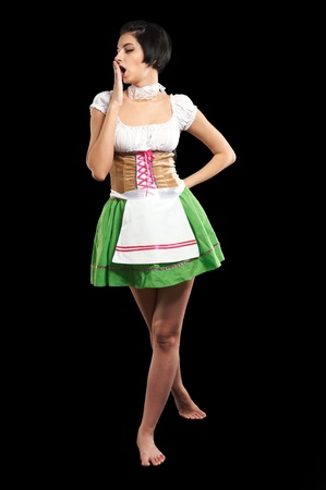 Beautiful woman in german beer girl costume  Isolated on black Stock Photo - 13094123
