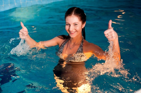 Young beautiful woman relaxing in swimming pool Stock Photo - 13318689