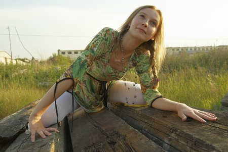 Young woman sitting on old railway cross tie Stock Photo - 13422117