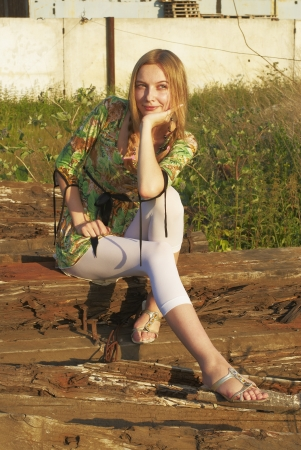Young woman sitting on old railway cross tie Stock Photo - 13740032