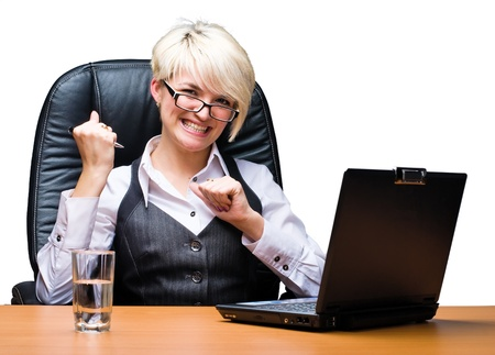 Business woman working on her laptop in office photo