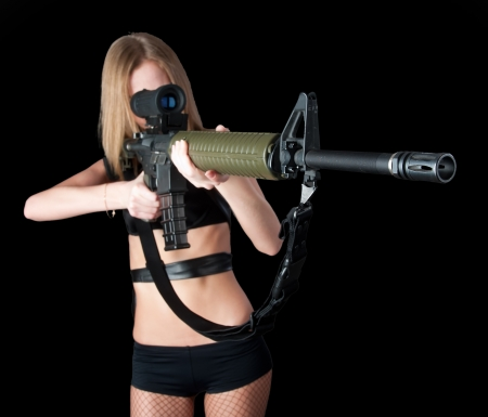 Young pretty woman aiming on gray  Focus on sight Stock Photo - 14058943