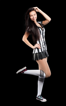 Beautiful Soccer Referee with whistle  Isolated on black photo