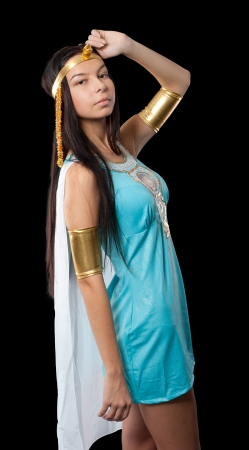 Pretty woman in egyptian queen costume  Isolated on black photo