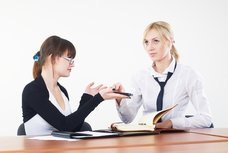 Meeting of attractive young businesswoman in office photo
