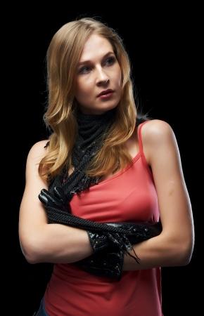 Beautiful girl model posing on black background photo