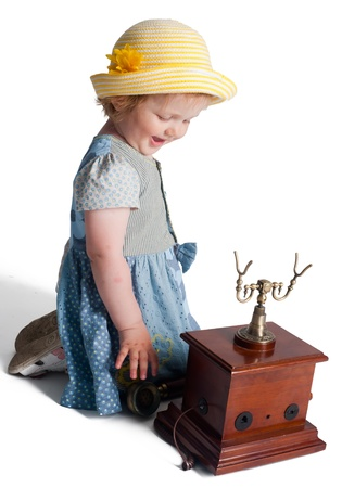 youngbaby: Little girl speaking by wired retro phone, Isolated on white