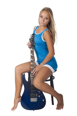 Young beautiful woman with electric guitar  Isolated on white photo
