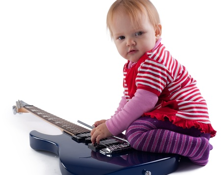 one year old: One year old girl playing with electric guitar