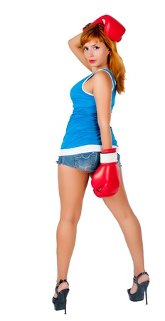 Young attractive woman with boxing gloves isolated on white background photo