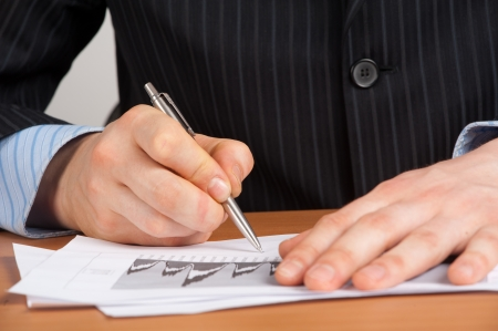 signing authority: Businessman working with documents in the office