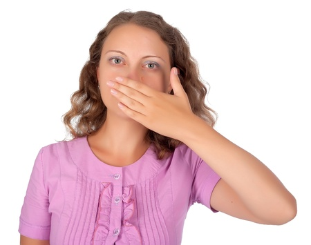 Young blonde woman covering her mouth with her hand Stock Photo - 15631414