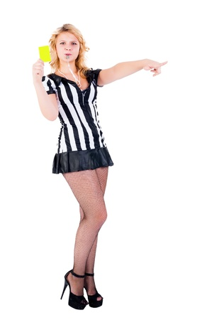 Young female referee showing the yellow card, isolated on white