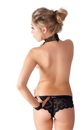 Beautiful topless woman standing with her back towards to camera Stock Photo