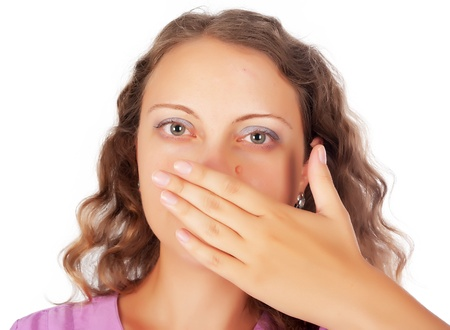 Young blonde woman covering her mouth with her hand photo