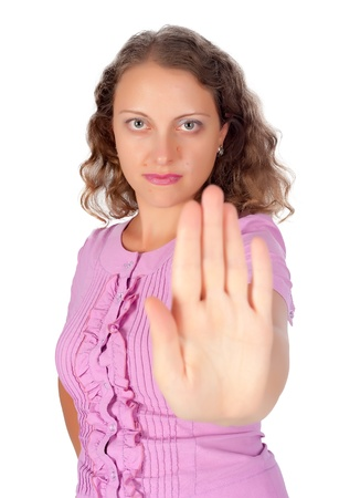 motioning: Young woman motioning to stop, focus on face  Stock Photo