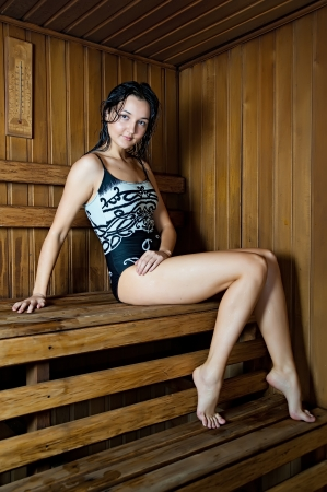 finnish bath: Young beautiful woman relaxing in a hot sauna