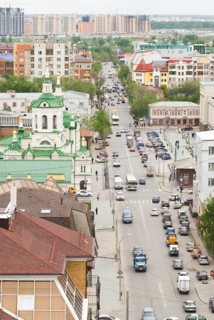 View at Tyumen city street with church from top point photo