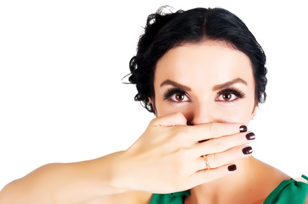 Young beautiful woman covering her mouth with her hand photo
