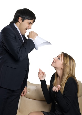 Man with emotional expression through megaphone to secretary photo