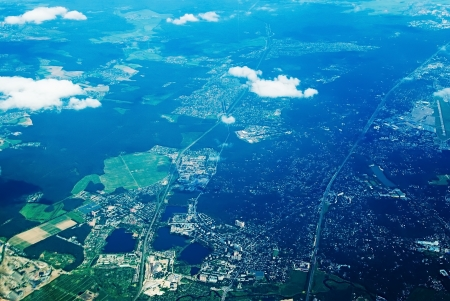Aerial view of houses and suburban streets in summer photo