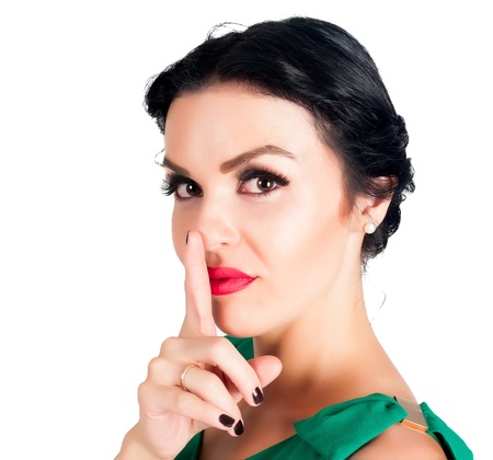 cant: Portrait of young woman with finger on lips Stock Photo