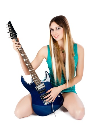 Sexy woman with guitar, isolated on white background photo