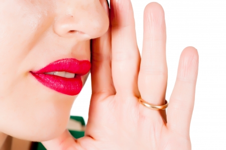 chatty: hand gesture of woman telling secrets, isolated on white Stock Photo