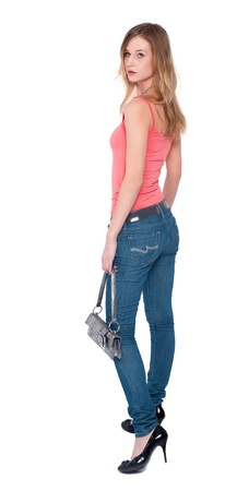 Portrait of fashionable young woman with hand bag photo
