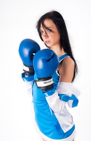 Young woman with boxing gloves isolated on white Stock Photo - 17380838