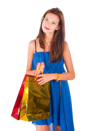 Shopping woman holding bags, isolated on white studio background Stock Photo - 17410751