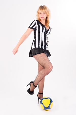 Beautiful Soccer Referee with ball at white background