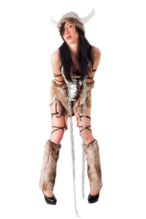 Young beautiful woman in barbarian costume  Isolated on white Stock Photo - 17453634