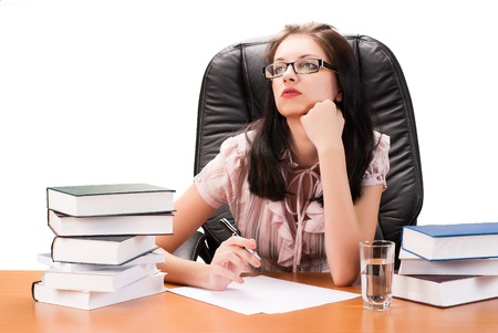 Portrait of pretty female executive sitting at an office table photo